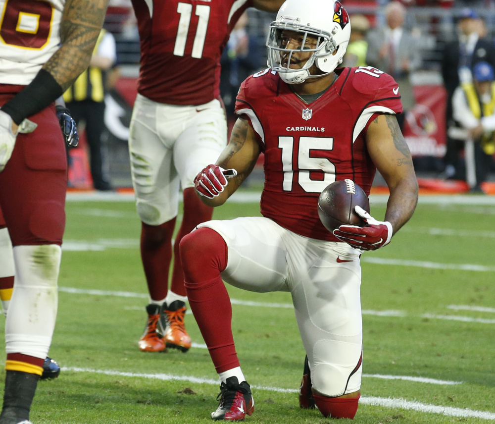 Arizona Cardinals wide receiver Michael Floyd (15) gets up after scoring a touchdown against Washington during the second half  Dec. 4 in Glendale, Ariz. (AP Photo/Ross D. Franklin)