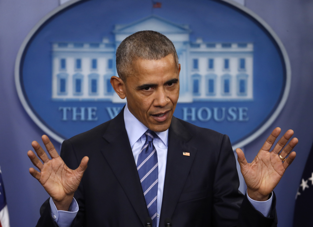 President Barack Obama speaks during a news conference in the briefing room of the White House in Washington on Friday.