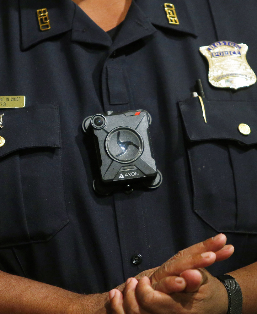 Boston Police Superintendent-in-Chief William Gross wears a body camera at a Sept. 12 news conference. Researchers said a study meant to assess the six-month pilot is not yet underway, and police haven't provided updates three months in, civil rights groups said.