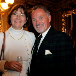 Melissa Nickerson Pratt of Westbrook with Dan Kennedy, who designed the parlor's Central Park theme.
