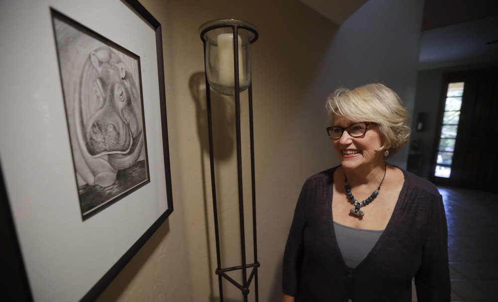 """Gayla Peevey, singer of that enduring Christmas classic, """"I Want a Hippopotamus For Christmas,"""" stands next to an image she drew of a hippopotamus, in her home in La Mesa, Calif."""