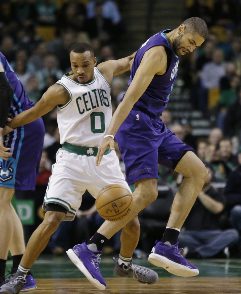 Charlotte guard Nicolas Batum dribbles while defended by Celtics guard Avery Bradley in the first quarter. Associated Press/Elise Amendola