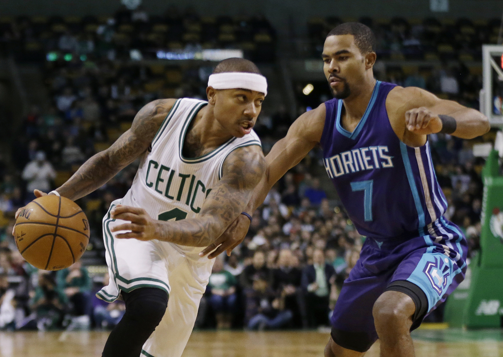 Celtics guard Isaiah Thomas drives against Hornets guard Ramon Sessions in the first quarter of Friday night's win for the Celtics in Boston. Thomas had 26 points in his return to action after sitting out four games with a groin injury.