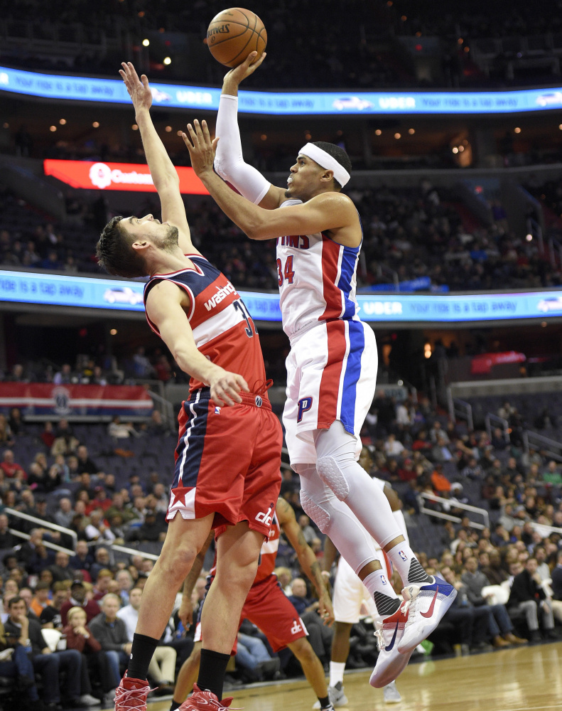 Detroit's Tobias Harris shoots over Washington guard Tomas Satoransky during the first half of a 122-108 win by the Wizards Friday at Washington.