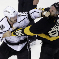 Kings left wing Kyle Clifford, left, and Bruins defenseman Kevan Miller fight in the first period Sunday in Boston.