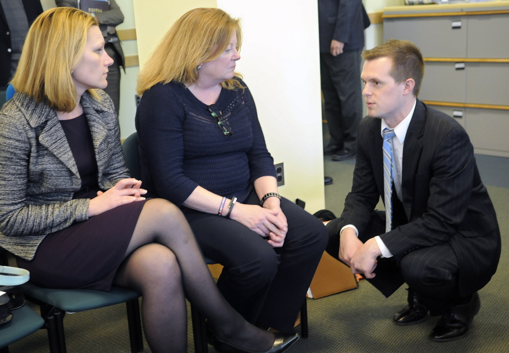 Volunteers of America vice presidents Melissa Morrill, left, and Julia Wilcox speak with Rep. Jared Golden, D-Lewiston, about legislation he sponsored to build housing for veterans in 2015.