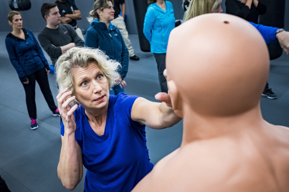 Flight attendant Gina Hernlem, 55, takes part in a self-defense seminar Dec. 2 near Dulles International Airport. More than 11,000 crew members nationwide have taken the Transportation Security Administration's voluntary four-hour course.