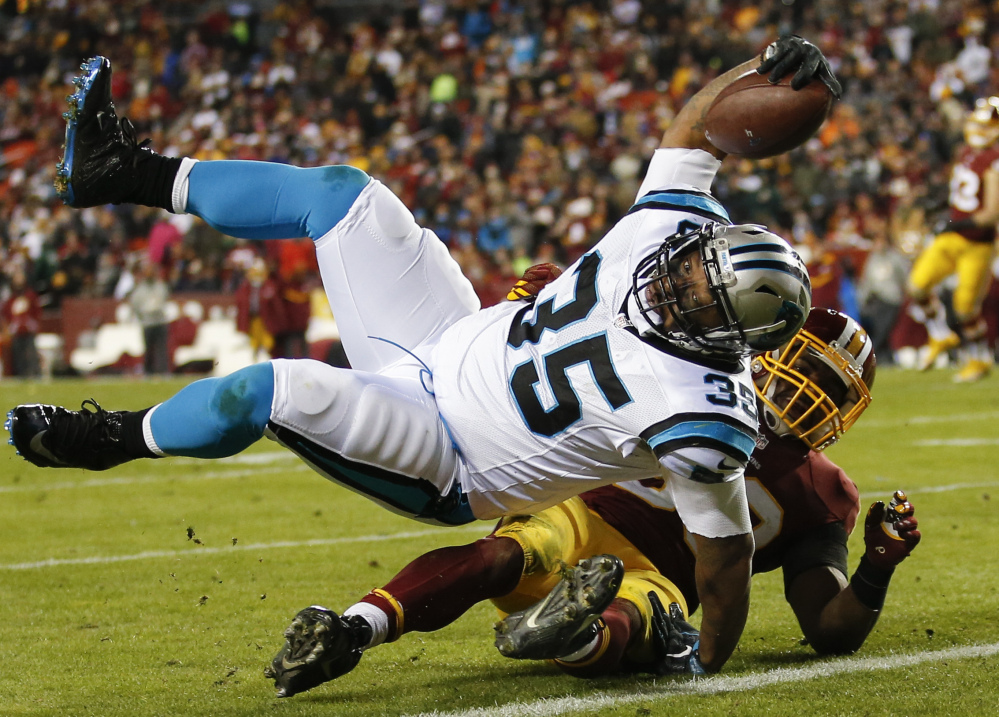 Panthers fullback Mike Tolbert rolls over Washington outside linebacker Martrell Spaight for a touchdown during the second half Monday in Landover, Md.