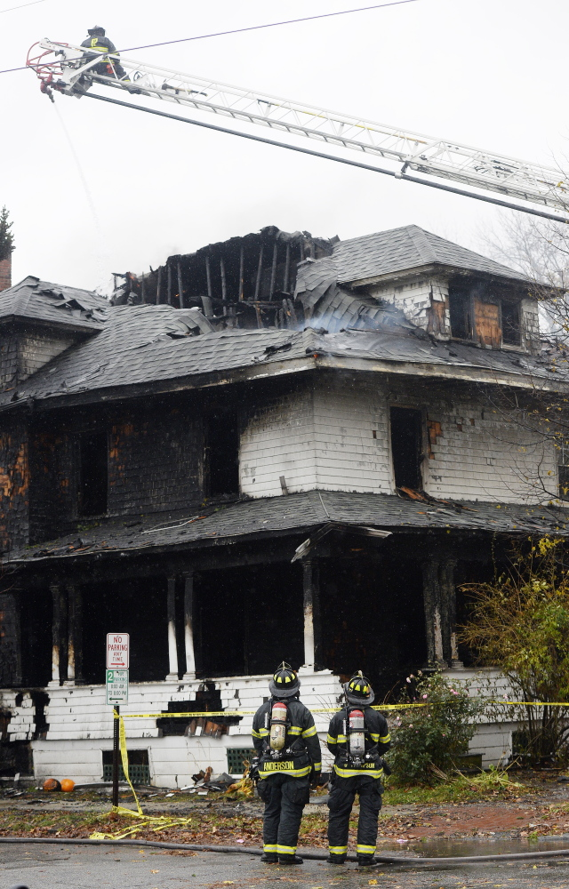The size of the third-floor windows in a deadly Nov. 1, 2014, fire at a Noyes Street apartment building, above, became a focus in the trial of landlord Gregory Nisbet. He was acquitted of manslaughter but found guilty of a code violation, sentenced to 90 days in jail and fined $1,000. Now Nisbet's lawyer is asking for a new trial, citing evidence he recently learned about.