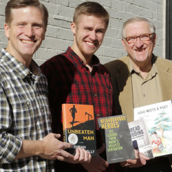 Brendan, left, Morgan and Edward Rielly with their books in Portland.