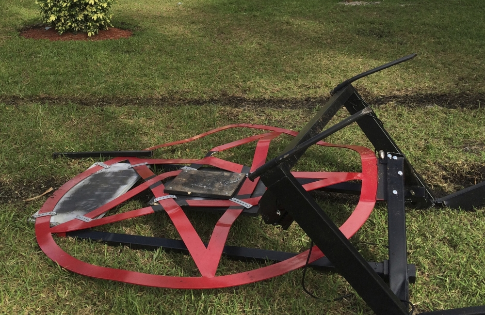 A pentagram erected by atheist Preston Smith lies damaged in Boca Raton's Sanborn Square in Florida on Tuesday.