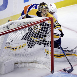 Islanders left wing Anders Lee, rear, catches Bruins goalie Tuukka Rask out of position as he pokes the puck in for a goal during the first period of the Islanders' 4-2 win Tuesday night in Boston.