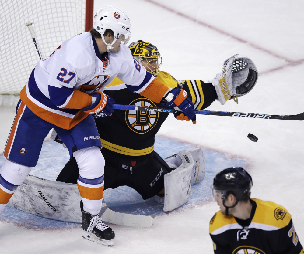 Islanders left wing Anders Lee tips the puck down in front of Bruins goalie Anton Khudobin in the third period of the Islanders' 4-2 win Tuesday in Boston.