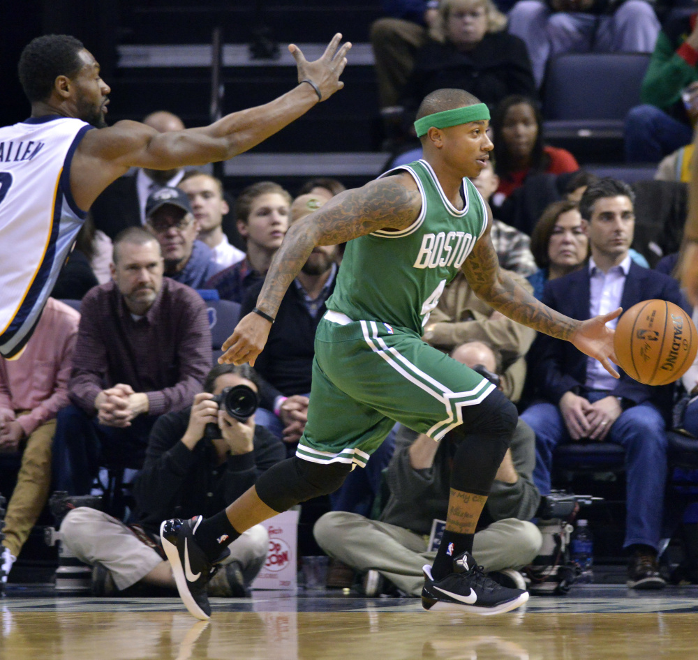 Isaiah Thomas drives past Memphis' Tony Allen in the first half  Tuesday night in Memphis, Tenn. Thomas had 44 points and the Celtics won in overtime, 112-109.