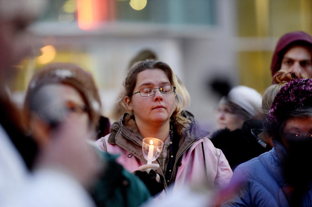 Kaitlyn Wiggins of Portland listens Wednesday as people share stories of homeless friends and family members who died in the past year. More than half of the homeless who died in Portland were in their 30s and 40s.
