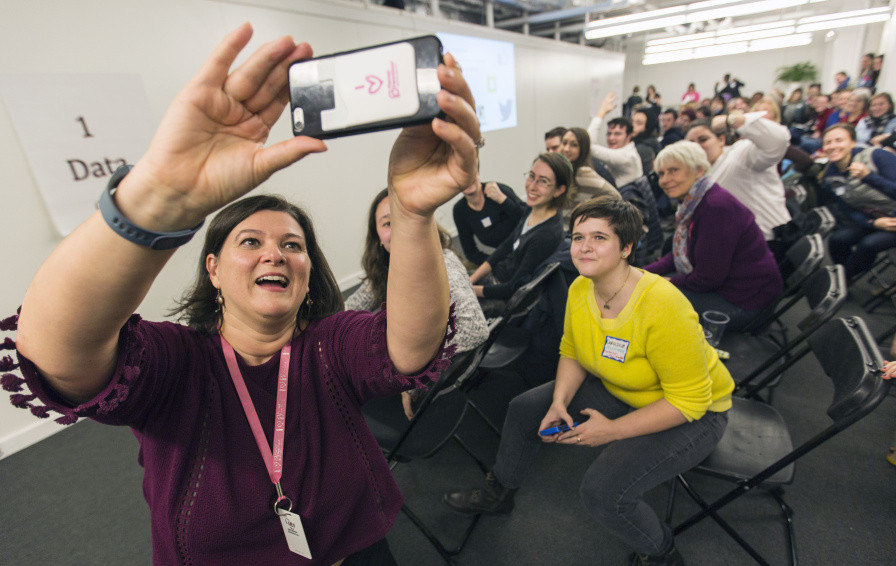 Nicole Clegg of Planned Parenthood takes a group selfie with supporters during an