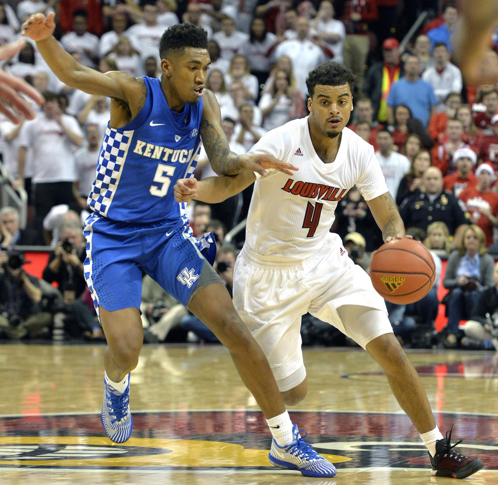 Louisville's Quentin Snider attempts to drive past the defense of Kentucky's Malik Monk during the second half of Wednesday's game in Louisville, Ky. Snider's career-high 22 points helped the Cardinals take a 73-70 victory in the in-state rivalry between two top-10 teams.