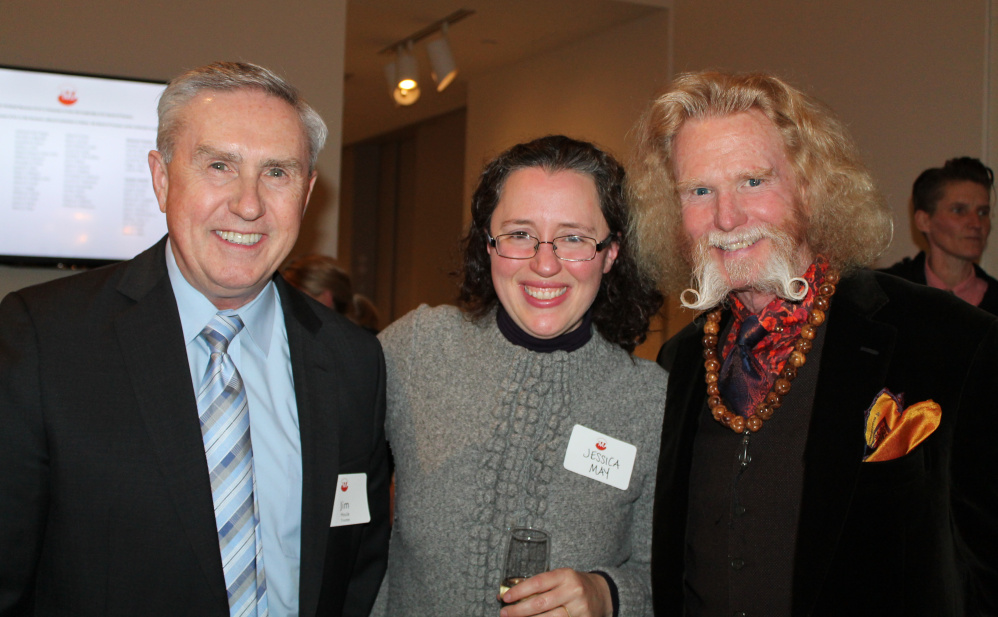 Jim Houle, left, Portland Museum of Art trustee, with chief curator Jessica May and Dr. Chris Hunt of Cape Elizabeth.
