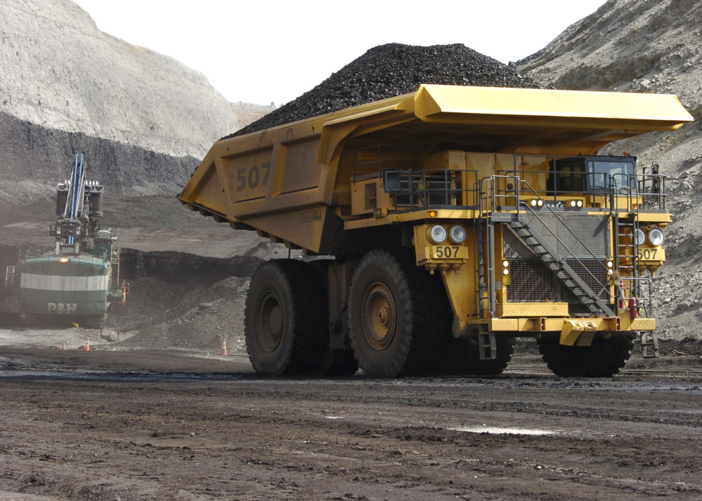 A truck hauls coal at Cloud Peak Energy's Spring Creek strip mine near Decker, Mont. President-elect Donald Trump's has promised to