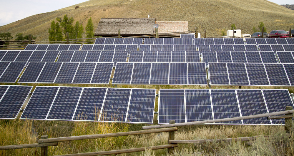 In recent years, huge solar and wind farms, like this one in Yellowstone National Park have sprouted up on public desert land in the western U.S., buoyed by generous federal tax credits. Donald Trump has called solar energy an