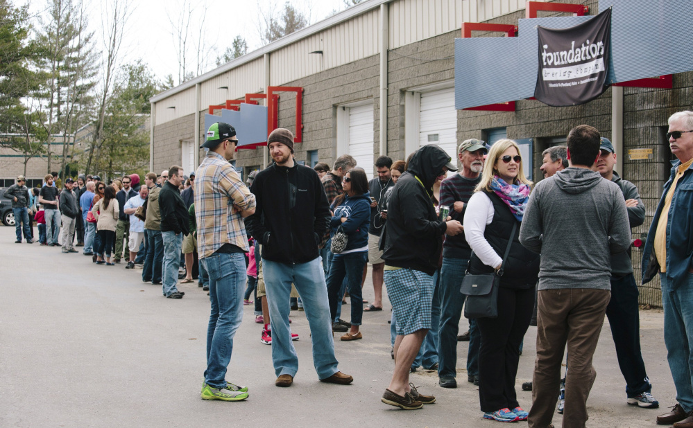 "Customers throng outside 1 Industrial Way in Portland's Riverton neighborhood for a specialty beer release at Bissell Brothers brewery on a Saturday in April 2015. With craft-beer stalwart Allagash just across the street, the area has become a destination for ""beer tourists."" File photo/Whitney Hayward"