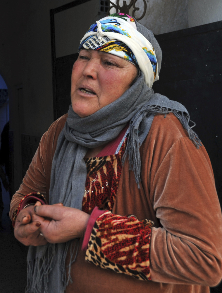Associated Press/Anis Ben Salah Nour El Houda Hassani, the mother of Anis Amri, reacts after the death of her son, in Oueslatia, central Tunisia, on Friday. Amri was shot dead early Friday in the outskirts of Milan, Italy.
