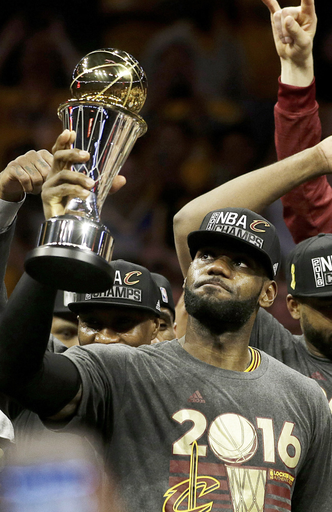 LeBron James of the Cleveland Cavaliers celebrates with teammates after capturing the NBA championship last June by defeating the Golden State Warriors 93-89 in Game 7 on the road.