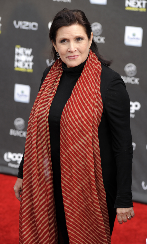 Actress Carrie Fisher, shown in 2011, is reported to have suffered a heart attack on a flight from London to Los Angeles.