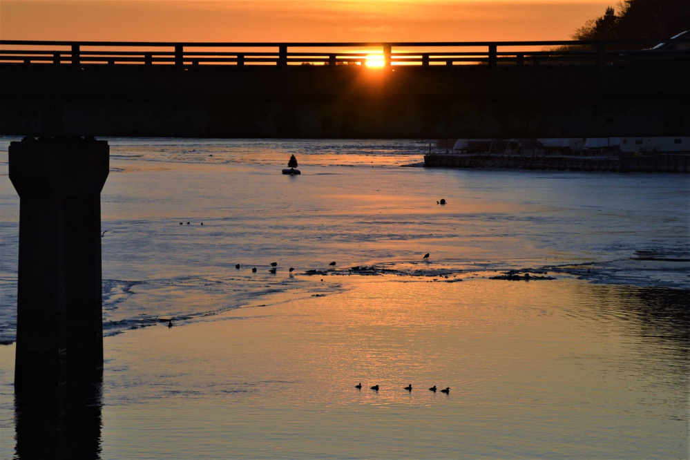 Frequent Your Turn contributor Brian Lovering witnessed the first sunrise of winter over the Royal River in Yarmouth – a sight that included a Christmas tree atop a raft floating in the middle of the river.