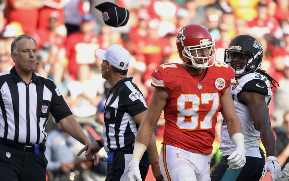 Field judge Mike Weatherford, left, throws his cap toward Kansas City Chiefs tight end Travis Kelce after Kelce, who was ejected for unsportsmanlike conduct, threw a towel in his direction during a Nov. 6 game against the Jacksonville Jaguars.