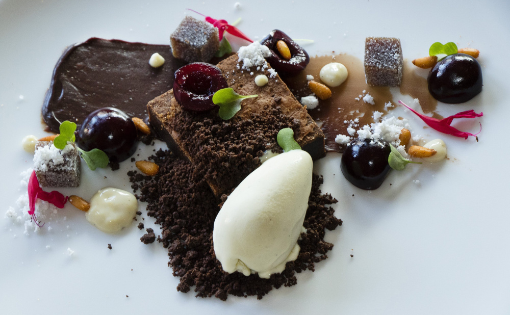 Bosque Negro, a triple chocolate brownie dessert with charred vanilla ice cream and pickled cherries at Local 188 restaurant.