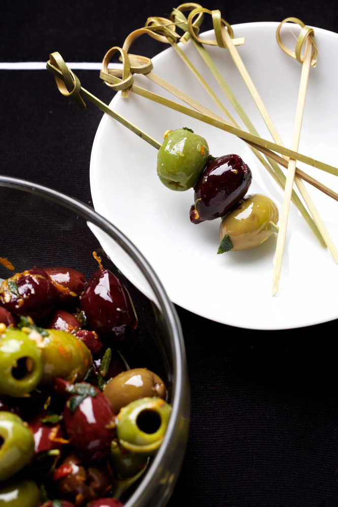 Olives with citrus zests and fried herbs.