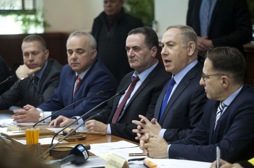 Israeli Prime Minister Benjamin Netanyahu, second right, attends a weekly Cabinet meeting in Jerusalem on Sunday. Netanyahu called a recent U.N. resolution