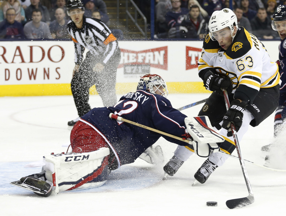 Columbus goalie Sergei Bobrovsky makes a save against the Bruins' Brad Marchand in the first period of the Blue Jackets' 4-3 win Tuesday night.