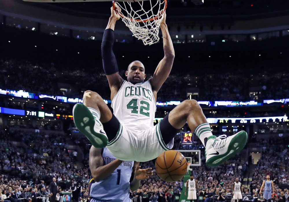The Celtics' Al Horford hangs from the rim after a dunk against the Grizzlies in the first quarter Tuesday night in Boston.