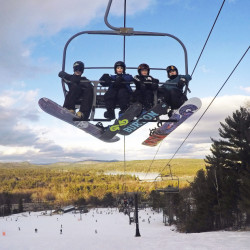 Young snowboarders ride a quad chairlift Tuesday at Shawnee Peak in Bridgton. If the snowstorm predicted for Thursday materializes, it will likely bring a strong end of the school vacation week for snow industry businesses and provide a good base for the rest of the season.