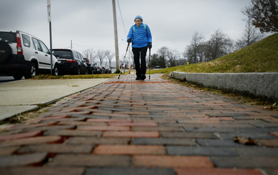 Seen using trekking poles in Portland in 2015, Bobbi Keppel is an advocate for pedestrians and elders. Senior housing and other programs help to keep older Mainers connected to others.