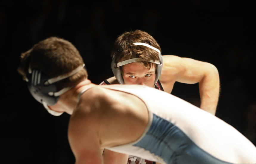 Jake Martel of Noble stares down his opponent, Dan Bliss of Mt. Mansfield in Vermont, during the Noble Invitational on Friday. Martel, who won the 132-pound division, defeated Bliss, a two-time Vermont state champion, 9-6. Noble captured the team championship.