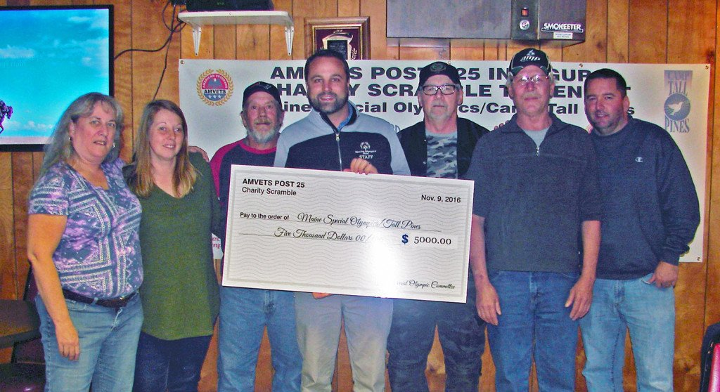 Carol Auspland, left, Tracy Burnham, Lewis Auspland, Ian Frank, Terry McGuinness, Richard Brown and John Burnham show the $5,000 raised for Maine Special Olympics' Camp Tall Pines at the event sponsored by Amvets Post 25 at Toddy Brook Golf Course in North Yarmouth.
