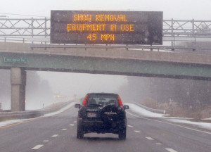 A car travels northbound on the Maine Turnpike  in Biddeford, where the speed limit was reduced to 45 mph Monday morning.