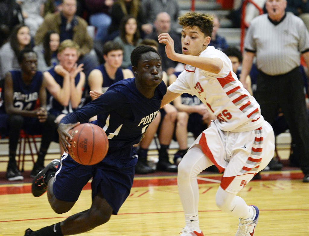Portland's Emmanuel Yugu drives against South Portland's Deandre White.