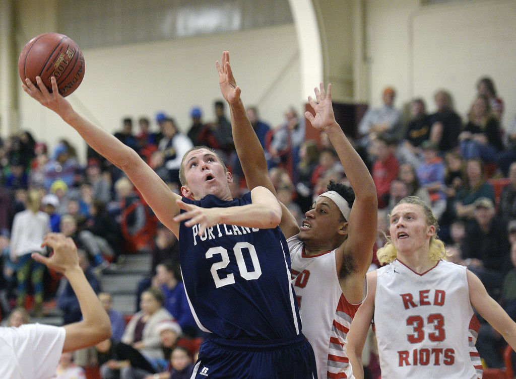 Portland's Griffin Foley drives to the basket against Ansel Stilley of South Portland.