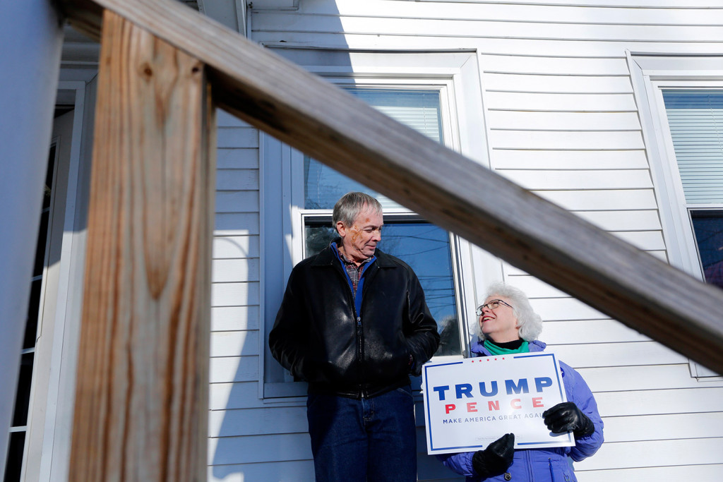 Joanne and Marshall Eaton, of Northeast Harbor, wait outside the Maine Republican Party headquarters in Augusta on Monday to help escort Chairman Rick Bennett to the State House, where he cast a ballot as a member of the Electoral College.