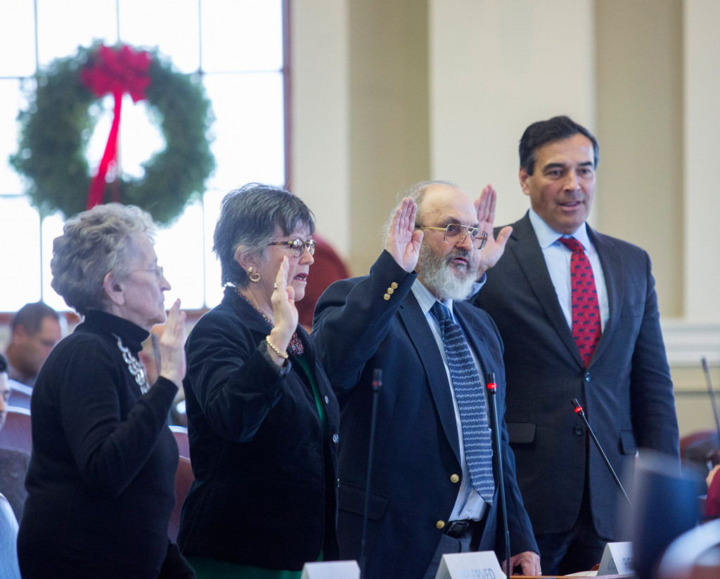 Maine Electoral College members take an oath before voting on Monday. David Bright, a Democratic elector, second from right, initially voted for Bernie Sanders but was ruled out-of-order and a second vote was taken, this time with Bright supporting Hillary Clinton. From left are Betty Johnson, of Lincolnville, Diane Denk, of Kennebunk, Bright, and Rick Bennett, of Oxford, the lone vote in favor of Donald Trump.
