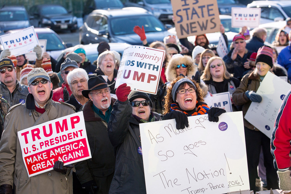 Trump supporters gather in front of Maine Republican Party headquarters in Augusta before escorting party Chairman Rick Bennett to the State House so he could cast his vote as a presidential elector Monday.