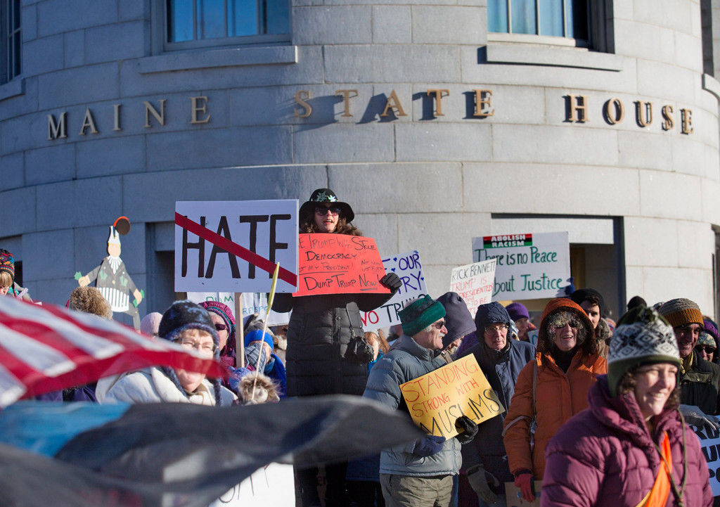 A large crowd of anti-Trump protesters gathers in front of the State House in Augusta on Monday prior to the Maine members of the Electoral College casting their votes for president.