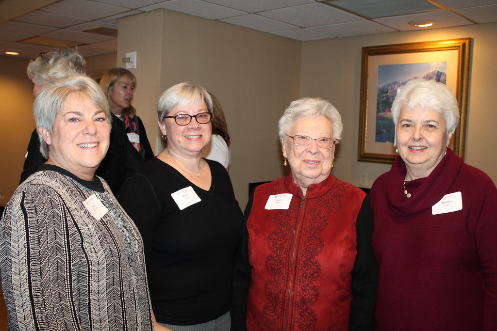 Ann McFarland, president of the Burns Family Foundation, enjoys a private reception before the luncheon with her sister Betsy Graves, her mother Olevia Watson, and Martha Lynch, a lawyer for the foundation.