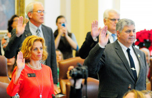 Sens. Amy Volk, R-Scarborough, and Scott Cyrway, R-Benton, are sworn in by Gov. Paul LePage on Wednesday Dec. 7, 2016 in the State House in Augusta.