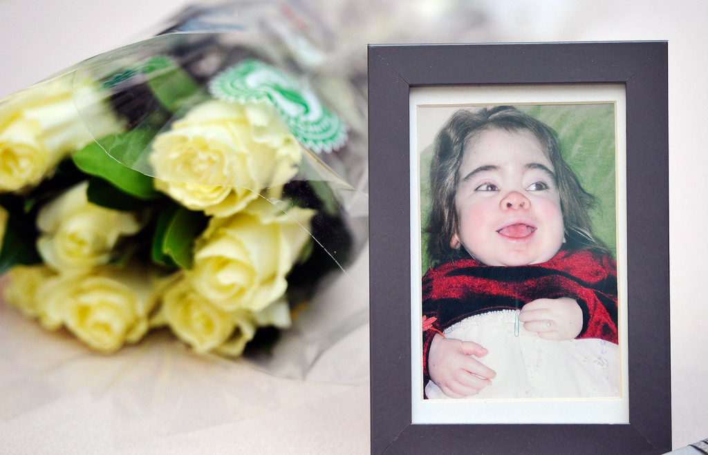 A photograph of Delaney Fuller sits on display on a table near the new stained glass tree created in her memory by her mother, Maine artist Laura Fuller, on Wednesday. Delaney died at Maine Medical Center in 2004 at the age of 9. She was diagnosed with Hurler syndrome, a genetic enzyme deficiency, when she was 4 months old and spent a lot of time at the hospital.