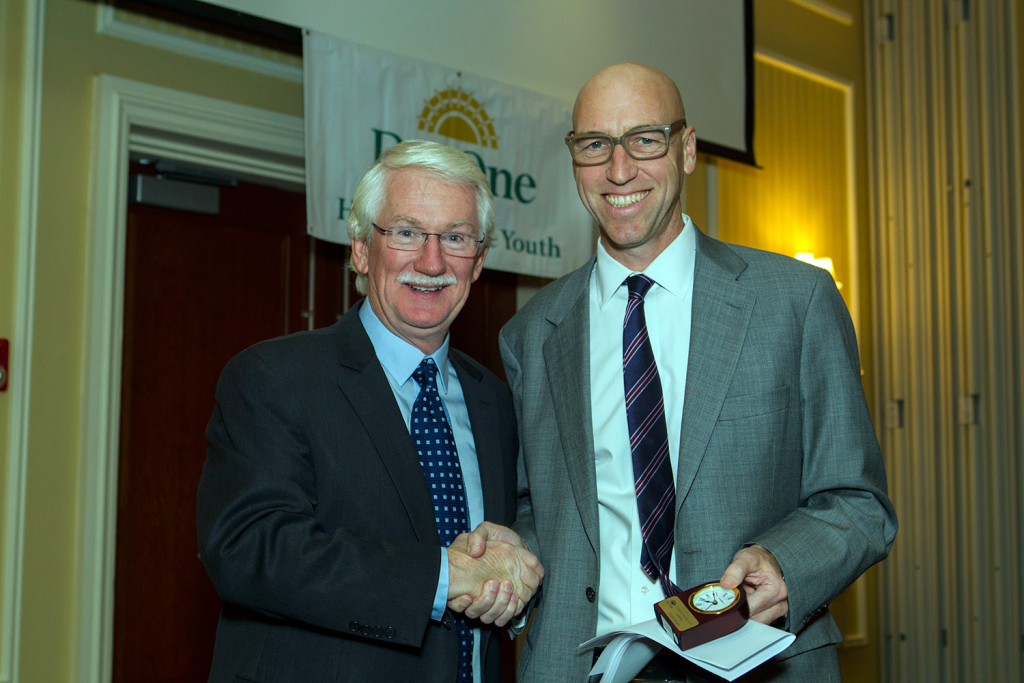 Day One MC Bill Green presented the Community Leadership Award to MEMIC Senior Vice President Mike Bourque.